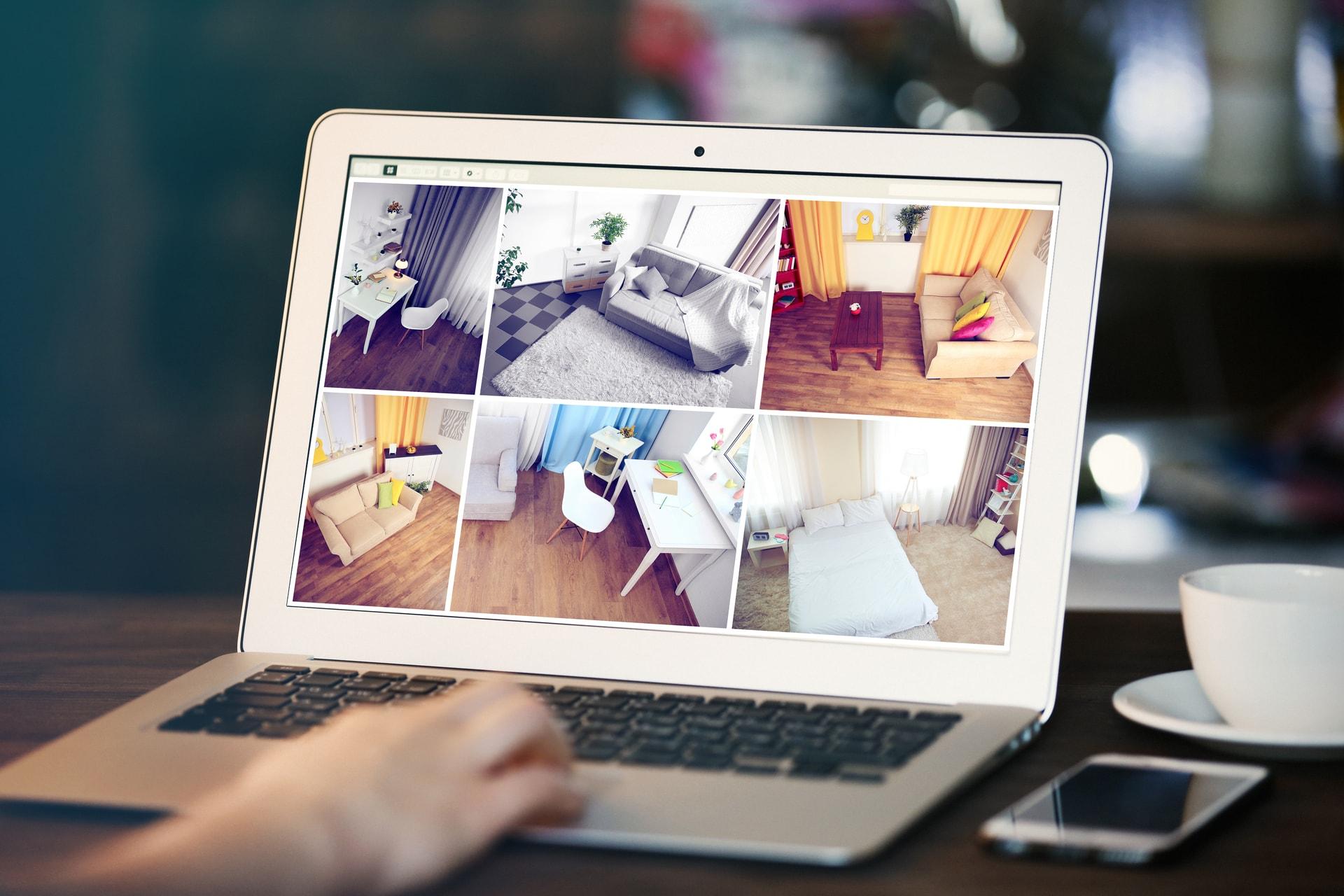 Vrouw raadpleegt haar huisbeveiliging op de laptop vanop afstand dankzij GW Security Group